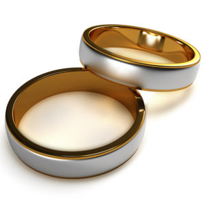 Two Tone Gold Men's Wedding Band with a polished and sandblasted finish.