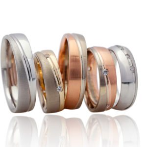 Various White, Yellow and Rose Gold Men's Wedding Bands with differing finishes including sandblasting, brush and polished finishes.