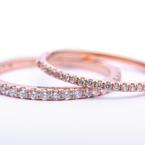 Rose Gold Diamond Wedding Bands set with a Saw set style
