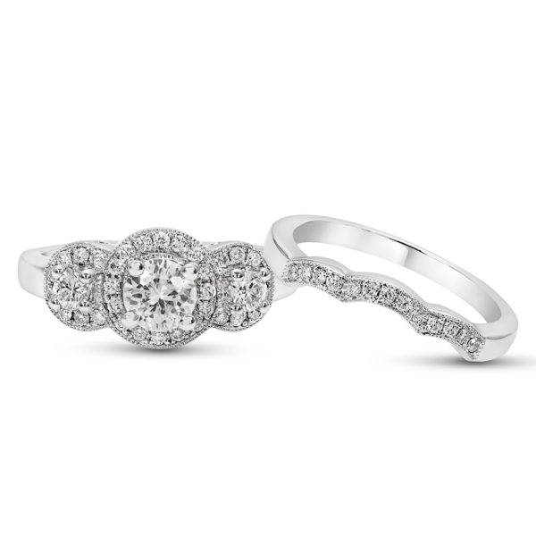 White Gold and Diamond Engagement Ring set with a Triple Halo and matching band in a pave style setting.