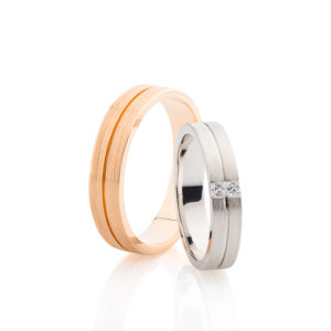Yellow Gold Men's Wedding Band with a brush finish and White Gold and Diamond Women's Wedding Band with Princess Cut Diamonds.